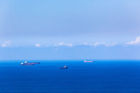 anchored: Ships Anchored blue ocean Stock Photo