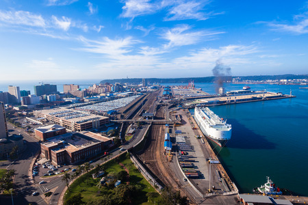 import and export business: Durban harbor port landscape from birds-eye air position.