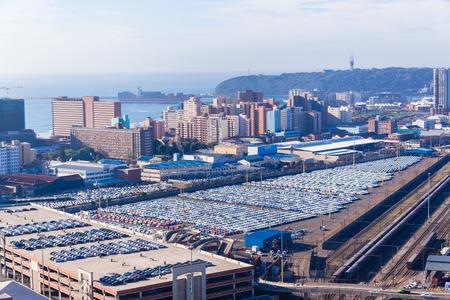 Durban harbor port car terminal export import landscape from birds-eye air position.
