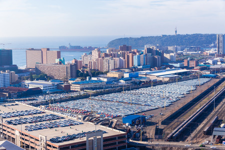 Durban harbor port car terminal export import landscape from birds-eye air position.