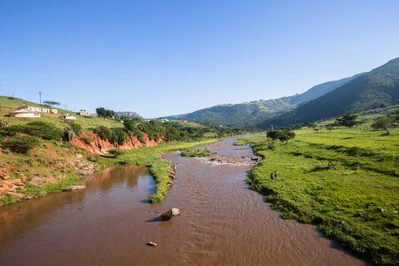 kz: Dusi river waters through valley hills rural wilderness landscape terrain.