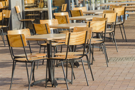dozens: Table chairs empty outside morning Stock Photo