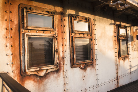 ancients: Old ship cabin windows  portholes rivets,decor of era in ocean transport