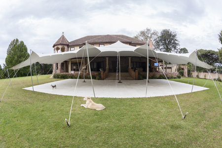 private party: Decor outdoors tent celebration dinner at private mansion home Stock Photo