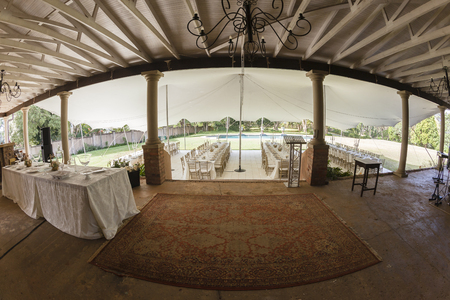 private party: Tent decor dining tables chairs cutlery outdoors party celebration dinner at private home