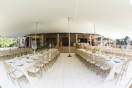 Tent decor dining tables chairs cutlery outdoors party celebration dinner at private home