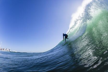 Surfen surfer paardrijden oceaan actie water achterste golf zwemmen.
