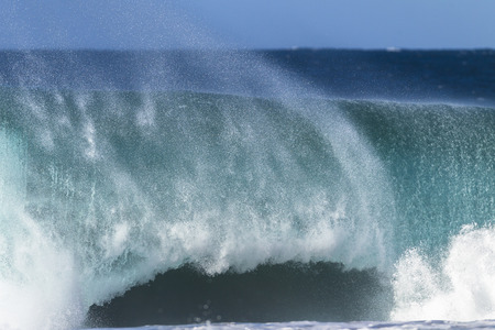 swell: Ocean large wave swell crashing hollow water energy power of nature on coastline beach.