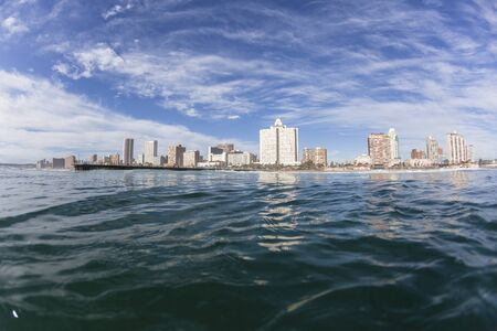 Durban beachfront swimming surfing water view of buildings hotels apartment landscape