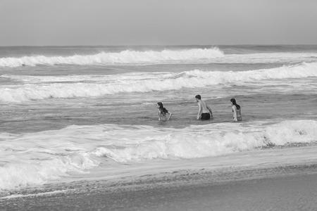 shorebreak: Boy Girls teenagers at beach swimming sea ocean shorebreak waves fun