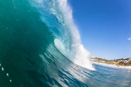 encounter: Ocean wave colors of water crashing hollow energy power swimming encounter. Stock Photo