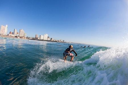 beachfront: Surfer junior boy surfing water action D rban beachfront