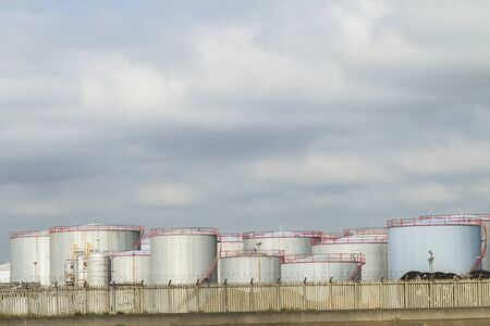 Refinery factory silos and storage tanks for oil production Stock Photo