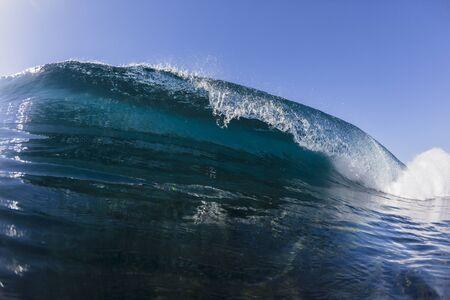 crashing: Ocean wave  blue water crashing power swimming closeup.