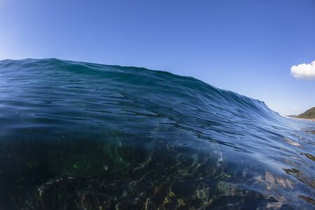 swells: Wave blue clear reef water swimming closeup.