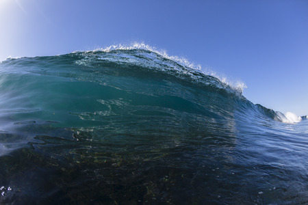 swells: Ocean wave glass reef blue water swimming closeup. Editorial