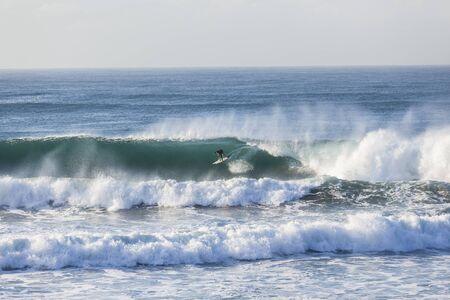 backhand: Surfing surfer backhand ride large ocean wave