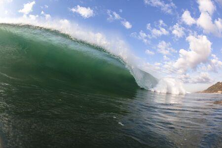 crashing: Wave ocean crashing breaking hollow water power swimming closeup.