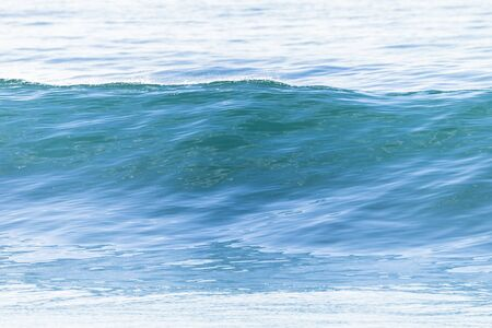 swell: Ocean wave swell glassy smooth water swell rolling to beach