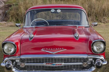 chevrolet: Chevrolet Vintage car of red color on field