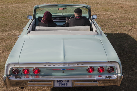 chevrolet: Chevrolet  Impala Vintage car with driver passenger on field collection display.