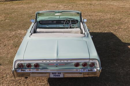 chevrolet: Chevrolet Impala Vintage car of color on field
