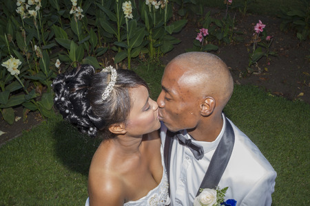 africa kiss: Wedding Romance Kiss bride and groom first day outside Stock Photo
