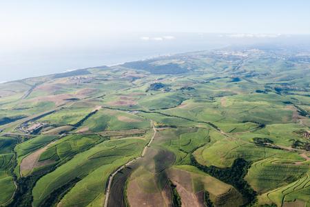 Aerial flying birds eye view sugarcane farm lands north coast coastline outside Durban