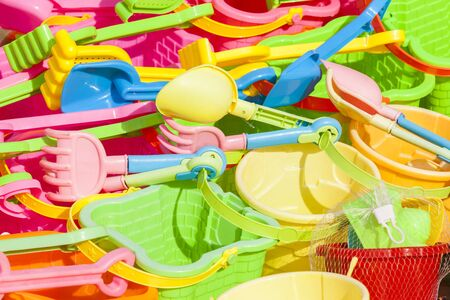 playtime: Children beach sand toys spade rake bucket colors abstract detail Stock Photo