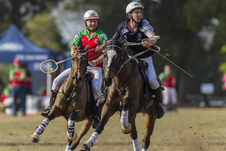 worldcup: Polocrosse sport world-cup New Zealands Shane Hill v Zambia play action at Shongweni equestrian fields Editorial