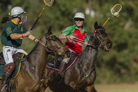 worldcup: Polocrosse sport world-cup Zambias Lauren Watson v South Africa  play action at Shongweni equestrian fields Editorial