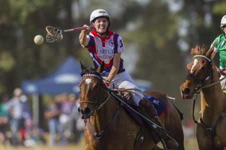worldcup: Polocrosse sport world-cup United Kingdoms Rachael Duhig v Ireland play action at Shongweni equestrian fields Editorial