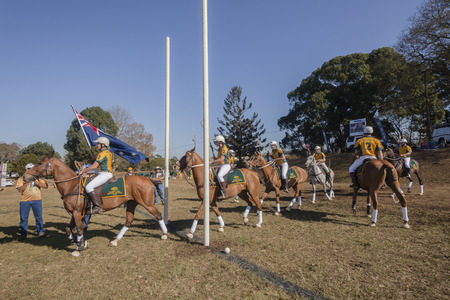 game play: Polocrosse Australian player riders world cup team march on 1st game play at polocrosse championship games at Shongweni equestrain fields outside Durban. Editorial