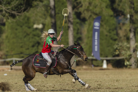 worldcup: Polocrosse sport world-cup game action Zambia Lauren Watson player rider at Shongweni equestrian fields