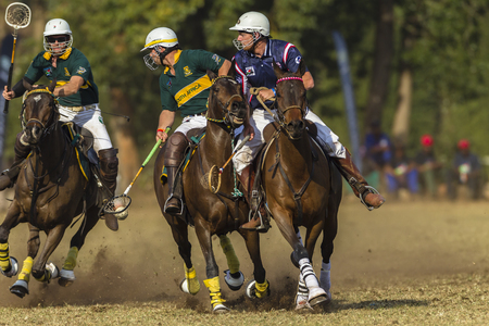 worldcup: Polocrosse sport world-cup game action South-Africa v USA player riders at Shongweni equestrian fields