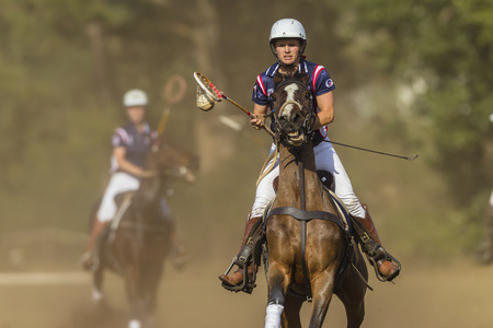 worldcup: Polocrosse sport world-cup game action USA women player rider Dori Johnson at Shongweni equestrian fields