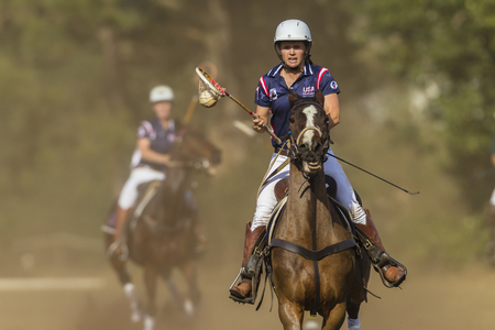 dori: Polocrosse sport world-cup game action USA women player rider Dori Johnson at Shongweni equestrian fields