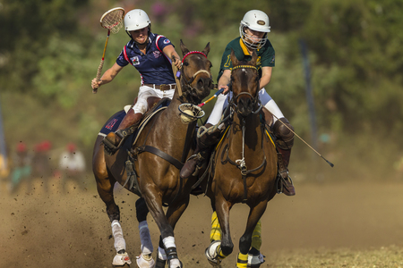worldcup: Polocrosse sport world-cup game action South-Africa v USA women player riders at Shongweni equestrian fields . Editorial