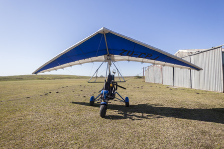 airstrip: Microlight aircraft plane on rural grass airstrip