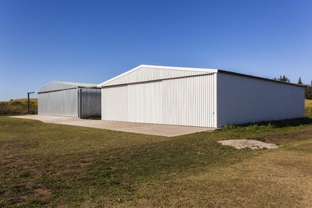 rural countryside: Buildings metal warehouse hangars rural countryside grass airstrip