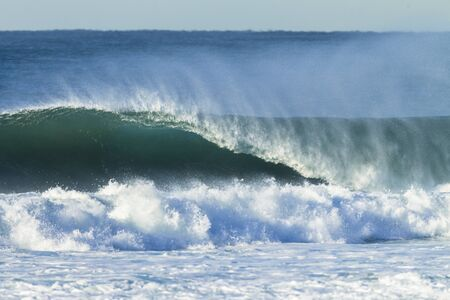swells: Ocean wave hollow crashing water power of nature.