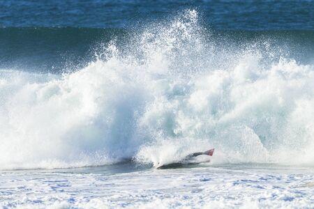 crashing: Surfing surfer crashing wipe out