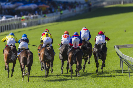 Horse racing jockeys and horses in closeup, speed action photo Editorial