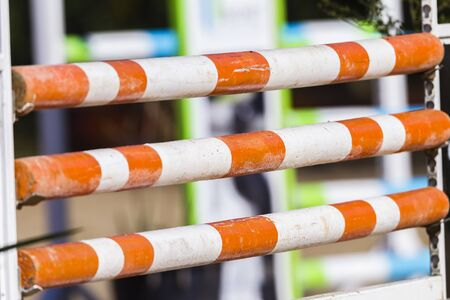 horse show: Equestrian horse show jumping gates poles colors on arena course.