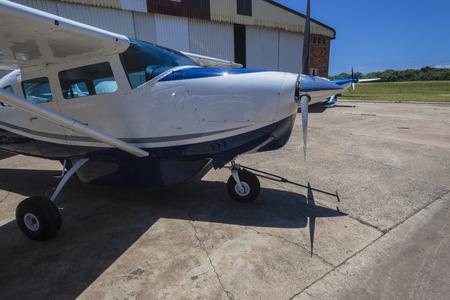 airstrip: Aircraft single prop plane outside hangar airstrip Stock Photo