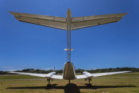 airstrip: Airstrip plane rear wing twin engined prop plane closeup abstract Stock Photo