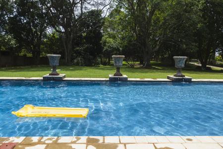 matt: Swimming pool blue water yellow air matt li lo home solitude. Stock Photo