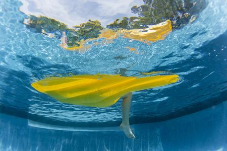 matt: Swimming pool underwater girl floating relaxing on yellow air matt li lo  home solitude.