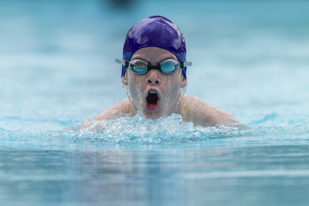 Swimming boy teen breastroke style race. Stock Photo