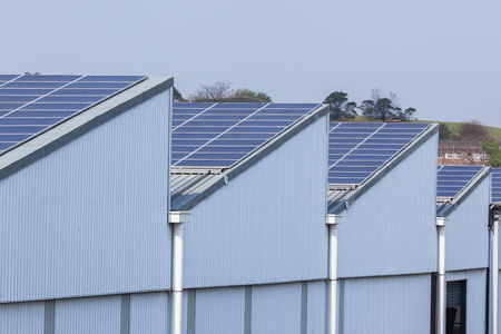 Solar panel screens cover building rooftops for clean energy power savings from sunlight